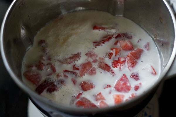 blend strawberry ice cream ingredients in a blender