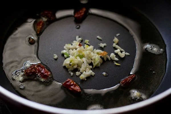 oil, red chillies and finely chopped garlic added to a frying pan