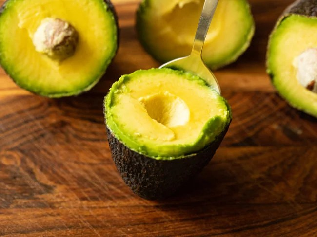Remove the seeds and scoop out the pulp with a spoon from the avocado halves