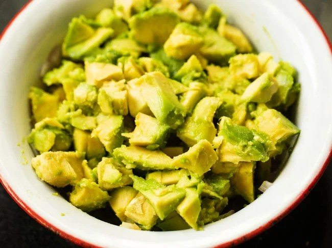 Place the chopped avocados in the mixing bowl