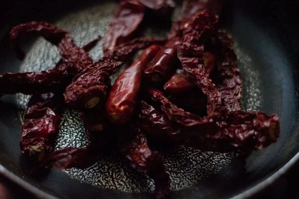 dry roast red chillies for preparing bisi bele bath masala recipe