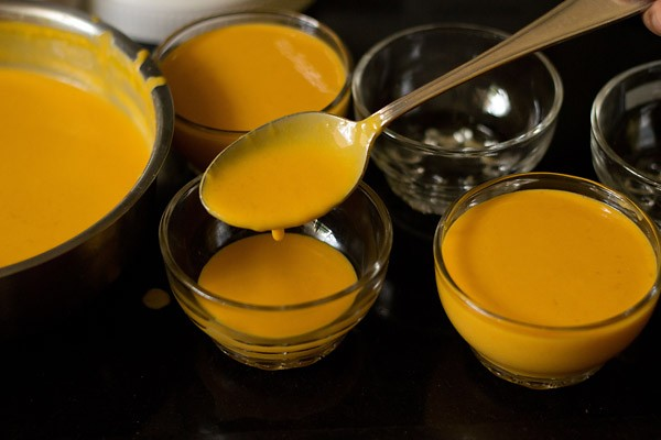 pouring the mango panna cotta in serving bowls
