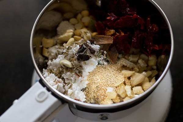 spices, nuts and seeds for vegan korma in a blender