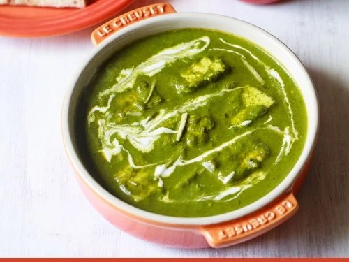 palak paneer served in a bowl