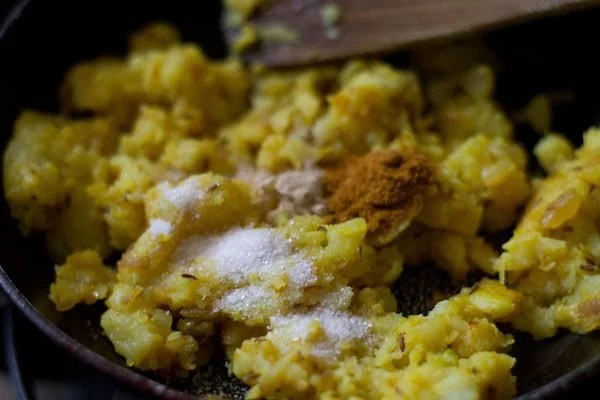 preparing stuffed capsicum masala