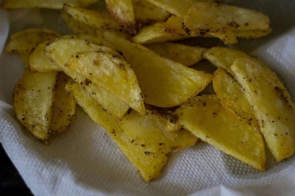 frying potatoes to make schezwan chilli potatoes recipe