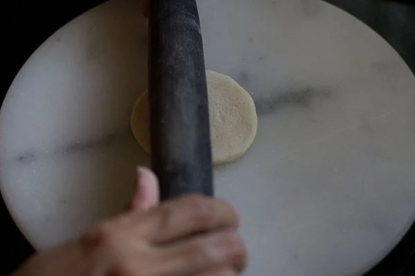 rolling the dough ball
