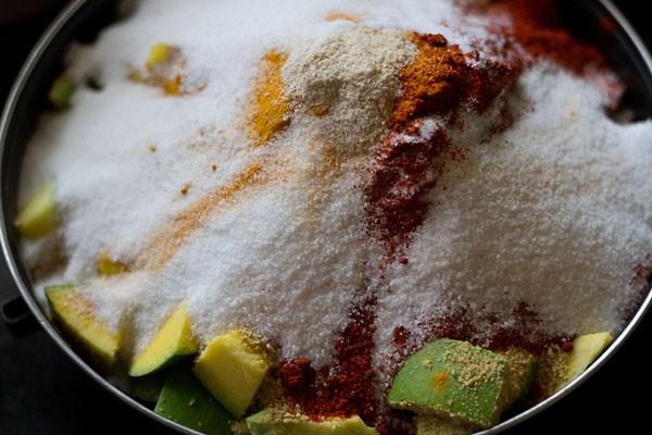 add spices for making gujarati mango pickle recipe