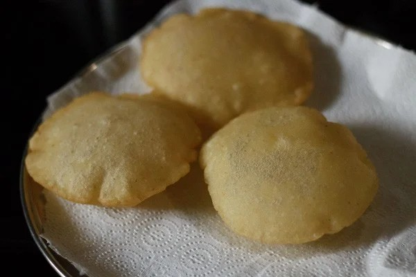 rice pooris recipe, tandalache vade recipe