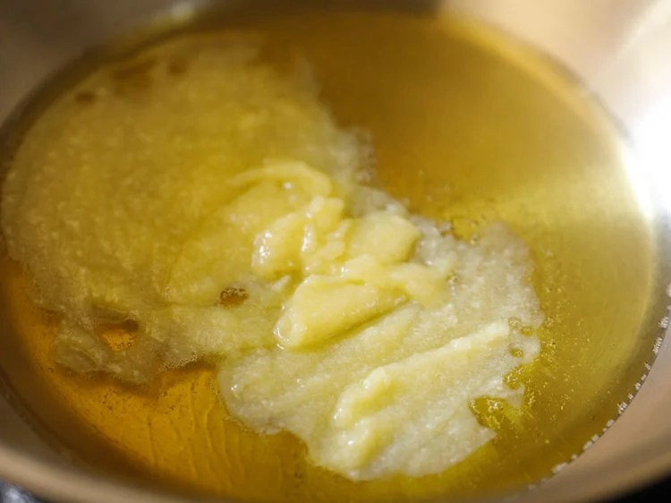 heating ghee in a heavy pan or kadai