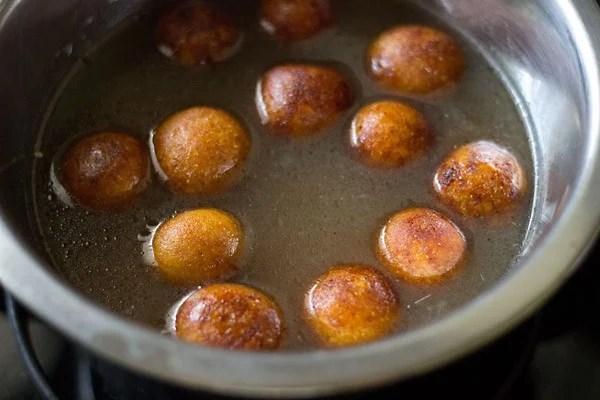 add gulab jamuns to sugar syrup