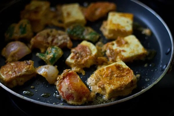 pan frying paneer tikka cubes