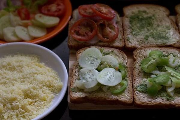 onion, tomato, potato and capsicum slices on bread slices