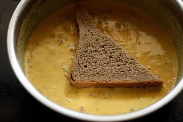 dip bread in besan batter