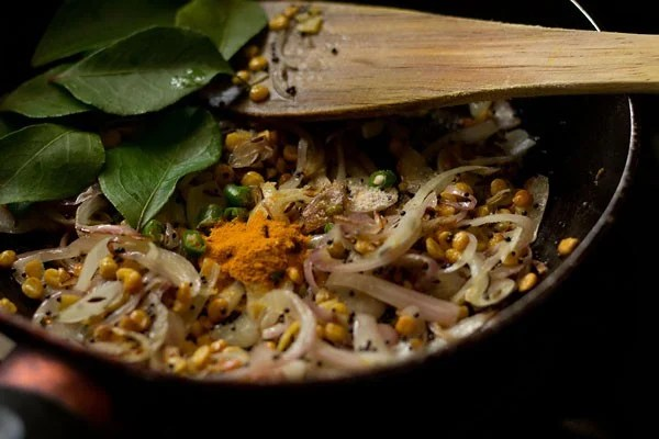 add curry leaves - making potato masala recipe