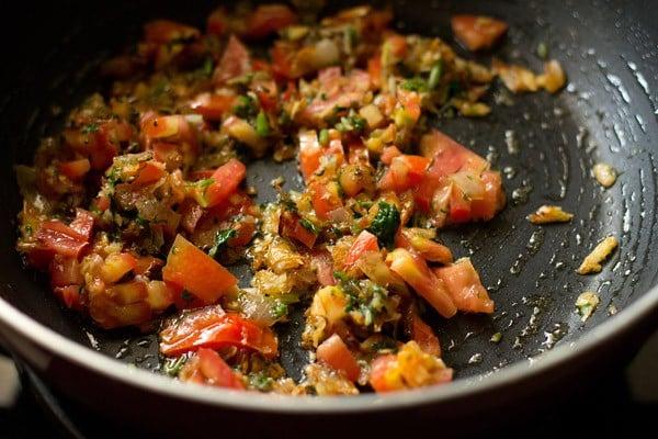 add tomatoes - making veg kolhapuri recipe