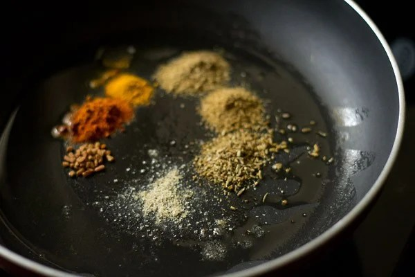 saute spices to make aloo rasedar recipe