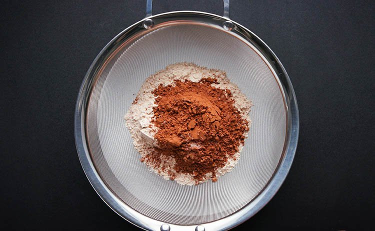 whole wheat flour, cocoa powder taken in a sieve