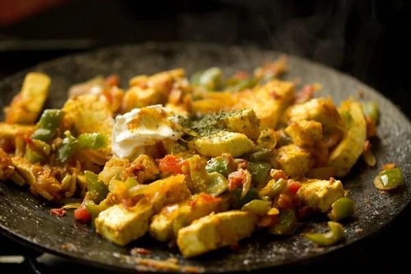 preparing paneer khurchan recipe