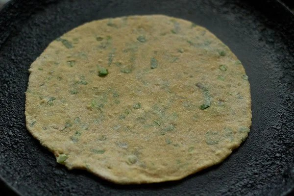 cooking mix veg paratha on tawa