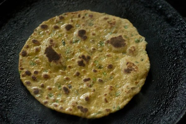 cooked vegetable paratha on tawa