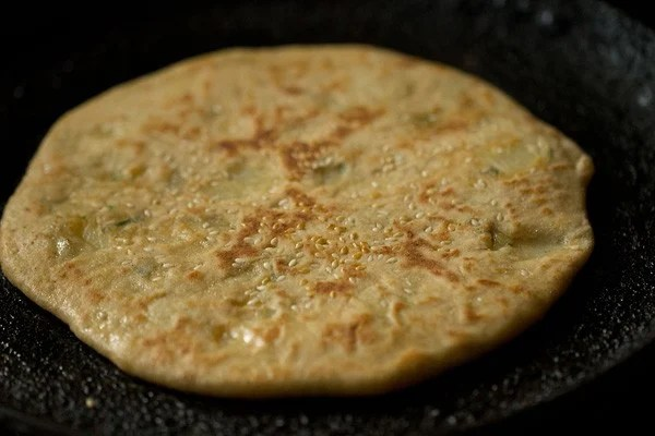frying aloo kulcha