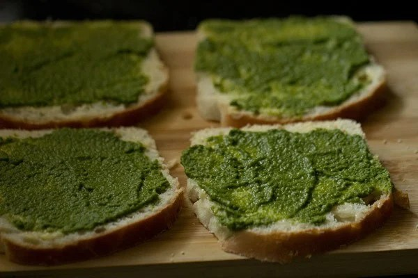 applying chutney on sandwich