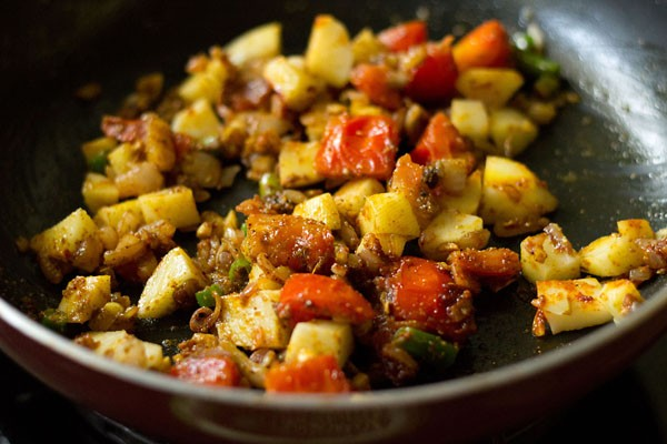 add potatoes to moong sprouts masala