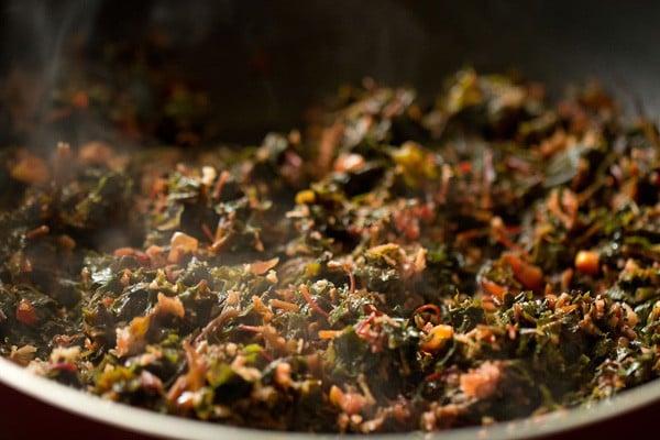 making tambdi bhaji recipe, red amaranth sabzi recipe