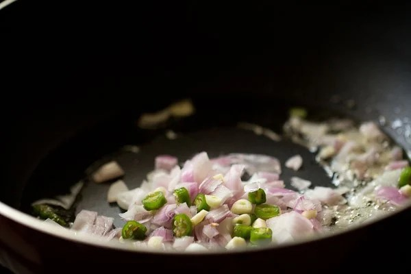 sauting onions for tambdi bhaji