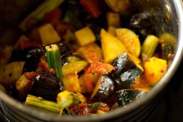 sauting veggies for veg kuzhambu recipe