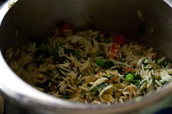 sauteing methi rice mixture in pressure cooker