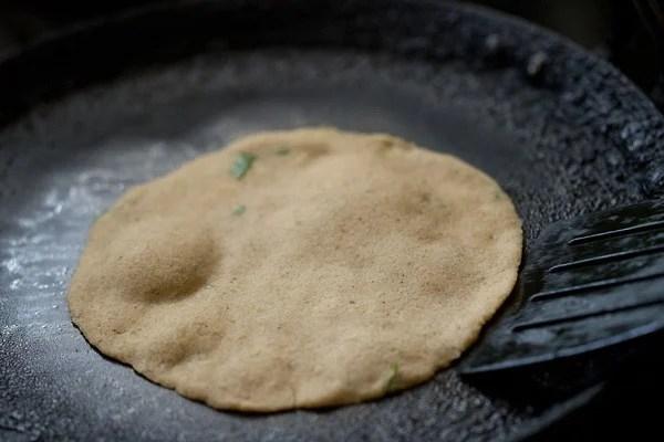 frying amaranth paratha