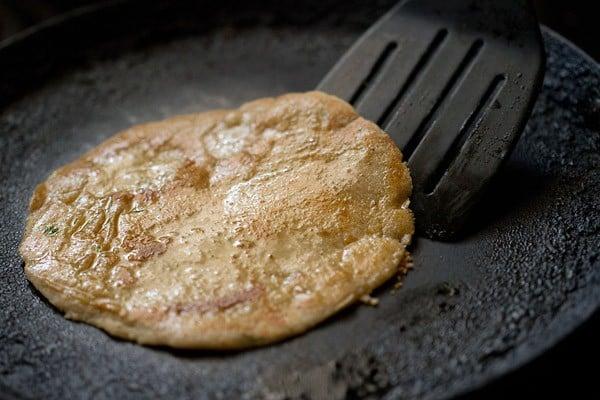 frying - making rajgira paratha recipe