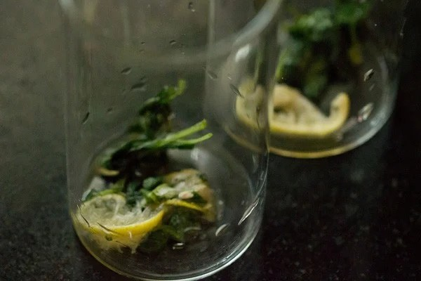 muddled ingredients for basil lemon mojito recipe