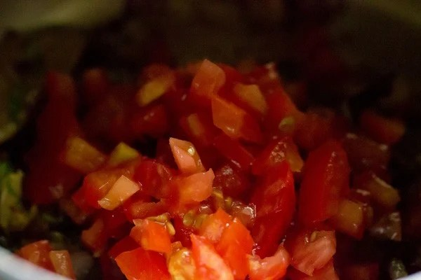 adding tomatoes for pulao recipe