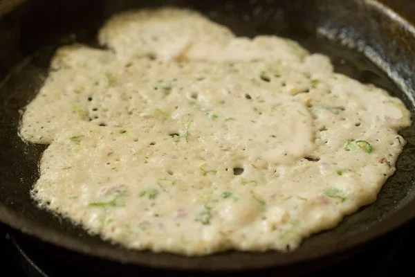 oats dosa on a medium flame