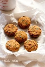 masala vada placed on thin kitchen paper towels