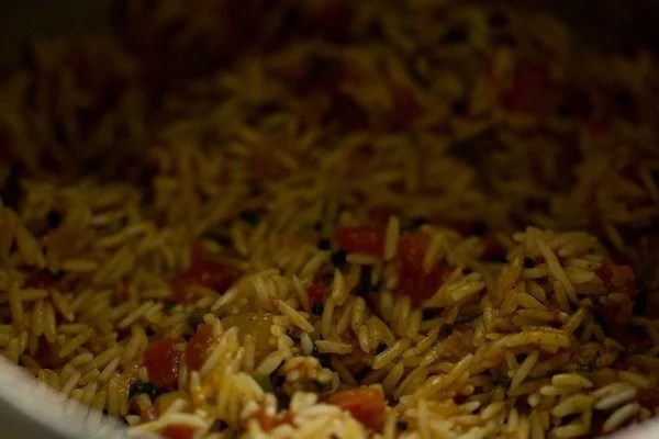 rice mixed with cooked tomatoes