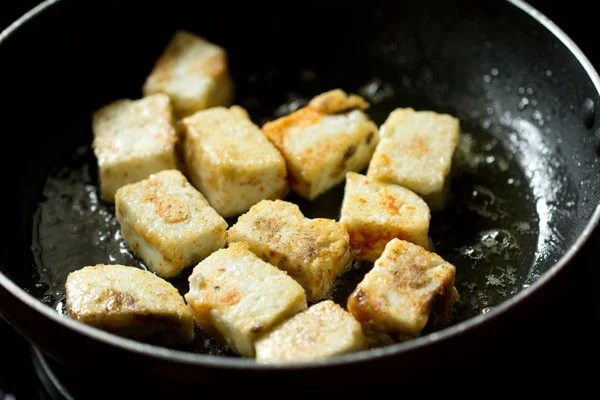 when the oil is medium hot, place the paneer cubes in the pan.