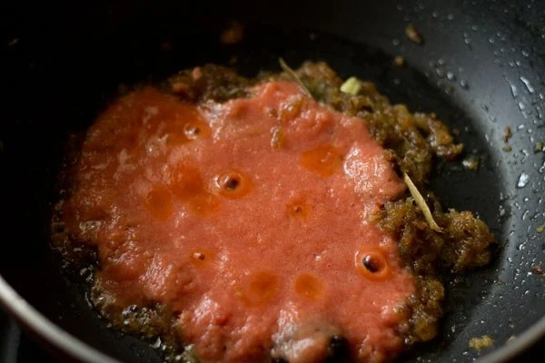 tomato puree added to pan