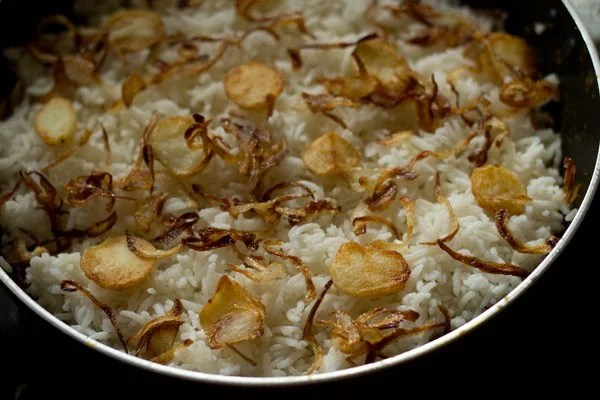 layering potato biryani