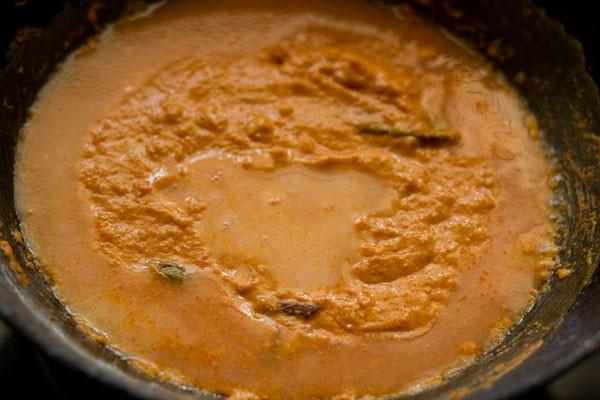 adding water to makhani gravy