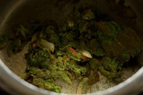sauteing green chutney paste