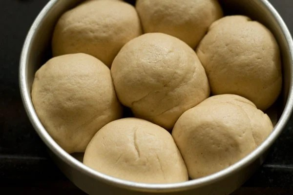 dough ball in a covered pan