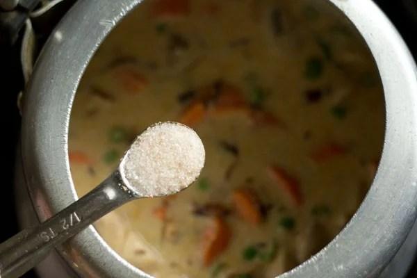 making vegetable gravy for Mughlai biryani