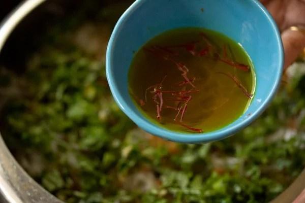 adding saffron water