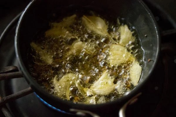 garlic cloves added to oil
