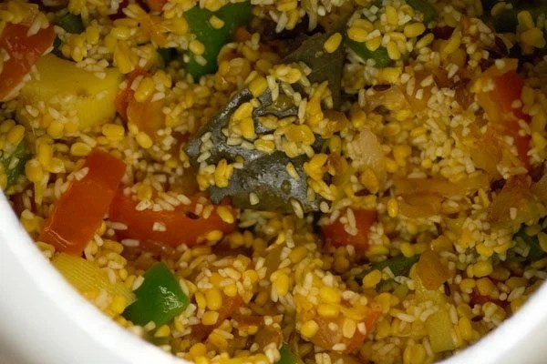 mixing masala khichdi mixture