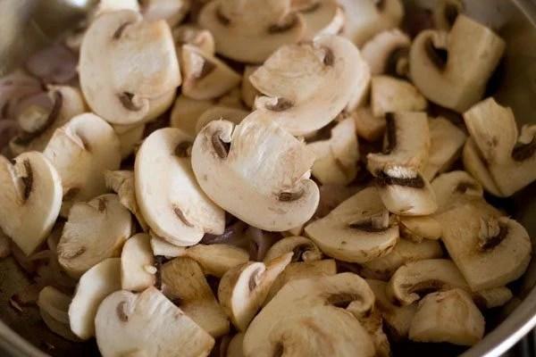 adding sliced mushrooms